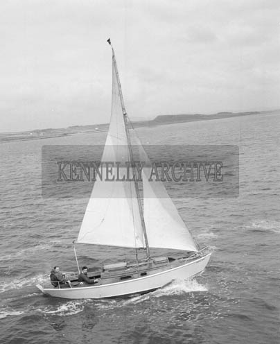 15th June 1964; A photo of Tralee Businessman Jerry O'Sullivan setting out from Fenit on a 1000 mile trip around the Irish Coast on 'The Geraldine', a boat he made himself.  Mr O'Sullivan was accompanied by his friend Peter Lawless as navigator.