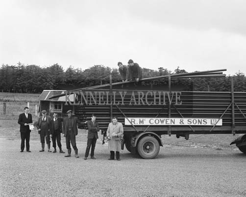 June 1964; A load of pipes for the water scheme in Tralee supplied by R. McCowan & Sons.
