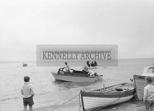 28th June 1964; A photo taken at the ceremony when the Very Reverend J.J. Murphy P.P., and Reverend Fr. Doherty C.C., Ballybunion blessed the boats of the North Kerry Sea Anglers Association at Beale Strand.