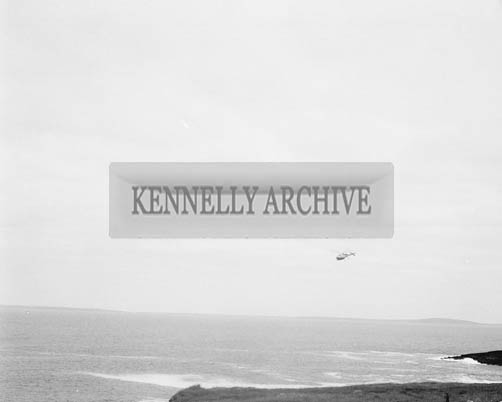 29th June 1964; A photo taken at Kerryhead where 26 year old Pat O'Connor of Meenogohane Causeway and Sargeant William McCarthy of Ballyheigue came to the rescue with a twenty foot canoe of two Dublin Merchant Seamen. The Dublin men, James Whelan and John Tyrell, had to abandon a disabled fishing vessel they had been ferrying from Kilronan, Aran to Dingle when the engine failed off Loop Head on Sunday evening. The boat drifted all night and though the men lighted tyres, threw up flares and hoisted a distress flag, nobody went to their assistance. When the boat struck the rocks at Bird's Island, the men put on life jackets and drifted for over two hours in the rough seas until picked up. By then John Tyrell was unconscious. He received artificial respiration but he died without regaining consciousness. The jury at the inquest returned a verdict of asphixia due to drowning as the cause of death.