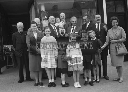 July 1964; Herr Patrick Schmidt, a member of the Traffic Policy Division, Federal German Ministry of Transport, paying a visit to his Uncle, Mr David Twomey, Castleisland. With Herr Schmidt was his brother-in-law, Dr Hans Seebohm, German Minister of Transport. The Twomey relations turned out in force to greet their cousin, from baby Twomey, a few months old, to 84 year old David. Included in the photo are the McElligotts, also relations of Herr Schmidt.