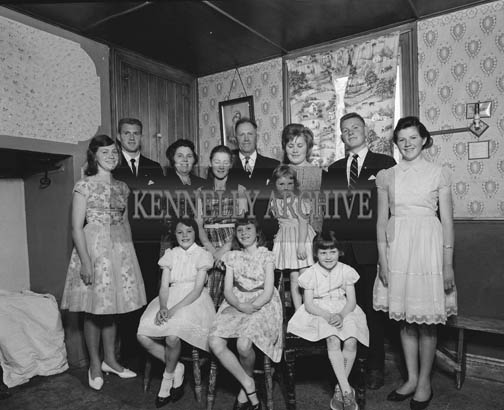 July 1964; A photo of a family, taken in their home.