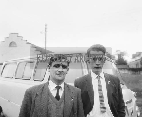 July 1964; A photo of two men with a van standing in front of a Hall.