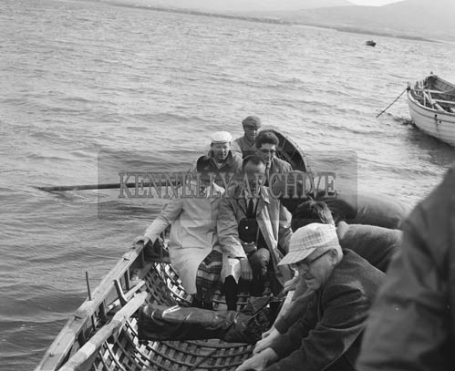 July 1964; A photo of people in a currach off Ballydavid on the Dingle Peninsula.