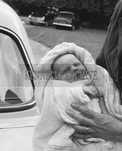 July 1964; A photo of Joe Treacy's baby at his Christening in St John's Church, Tralee.