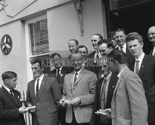 Sunday 26th July 1964; Members of the Stella Maris Rowing Club in Dublin, make presentations to the principal rescuers of Seaman Jimmy Whelan off Kerryhead. In front, presenting the gifts are Tommy Tyrell, brother of the victim Seaman John Tyrell, and Paddy Whelan, brother of the rescued man. Immediately behind are the heroes, Patrick O'Connor, Sargeant William McCarthy and Timothy Casey. The group at the rear includes: D. Tracey, J. Moore, R. Sheehy, W. McCarthy, S. Purcell, D. Quinn, S. Nolan, R. Manley, S. Quinn, M. Purcell and J. Corcoran. The photo was taken outside the Imperial Hotel, Denny Street, Tralee.