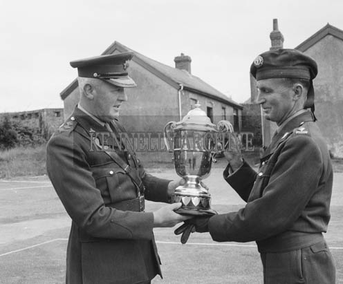 Thursday 30th July 1964; Commandant Michael Scannell receivung the Thomas Ashe Cup from Colonel William Donagh at Ballymullen Barracks.