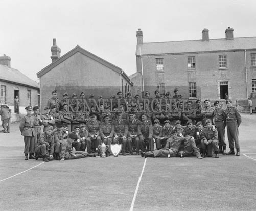 Thursday 30th July 1964; Tralee FCA 'A' Company, winners of the mortar competition at Kilworth with their trophy in Ballymullen Barracks, Tralee.