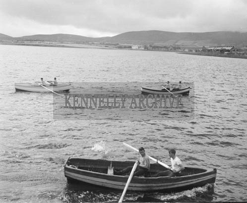 10th August 1964; A photo of a currach race in Dingle Regatta.