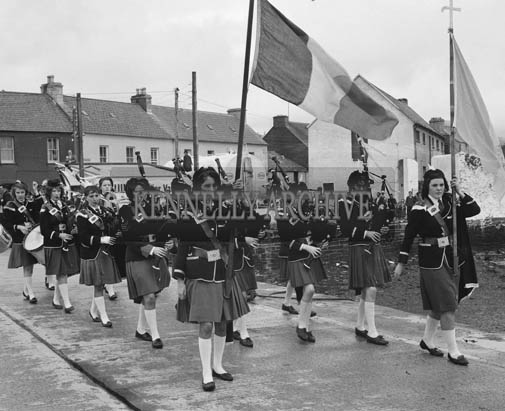 10th August 1964; A photo of a pipe band at Dingle Regatta.