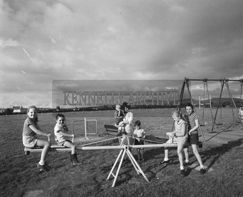 September 1964; Jerry Kennelly (centre) in the playground in Tralee Town Park.