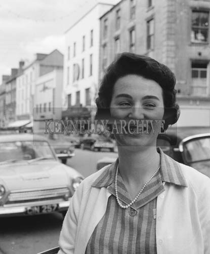 29th August-3rd September 1964; A photo of a woman in Castle Street, Tralee, during the Festival of Kerry.