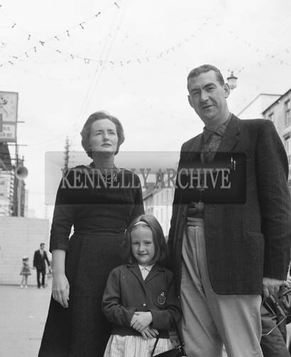 29th August-3rd September 1964; Maeve and Joe Grace with their daughter in Castle Street, Tralee, during the Festival of Kerry.