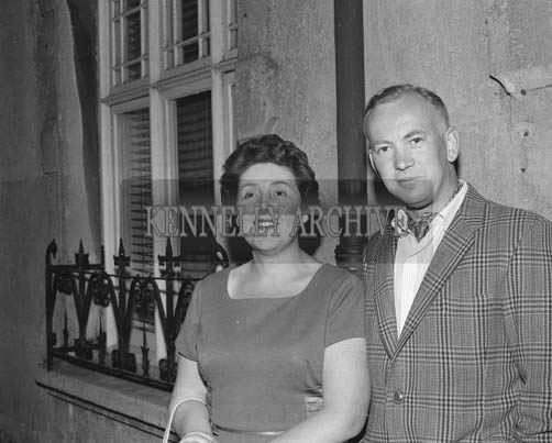29th August-3rd September 1964; A photo of a couple in Denny Street, Tralee, during the Festival of Kerry.
