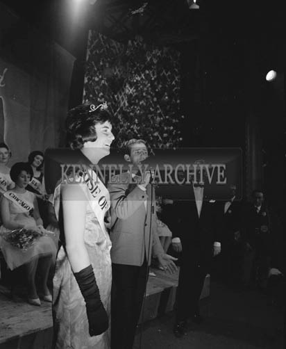 29th August-3rd September 1964; Dickie Rock sings to Margaret O'Keeffe from Oakpark, Tralee onstage in the Ashe Hall after she was crowned the 1964 Rose Of Tralee.