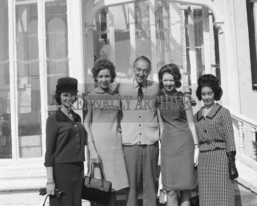 29th August-3rd September 1964; Charles Fitzroy poses for a photograph with the Roses at Cloghers House in Tralee, during the Festival of Kerry.