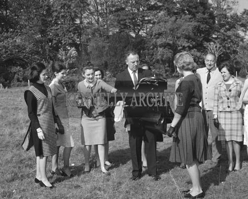 29th August-3rd September 1964; A man looks after the handbags for the Roses in Cloghers House during their tour.
