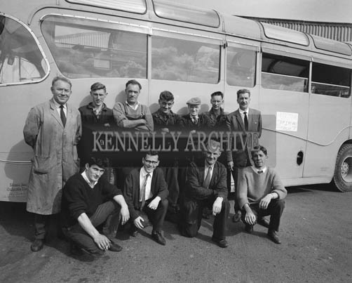 29th August-3rd September 1964; CIE Staff pose for a photo in front of the Roses' Tour Bus in Casement Station, Tralee.