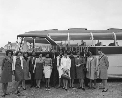 29th August-3rd September 1964; The Roses pose for a photo in front of their bus during the Rose Tour.