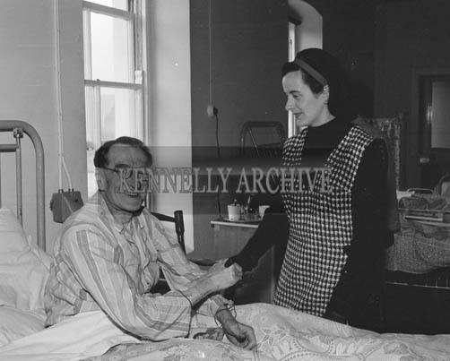 29th August-3rd September 1964; A Rose speaks with a patient at the County Hospital, Killarney, during the Rose Tour.