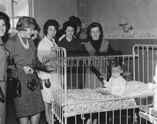 29th August-3rd September 1964; Roses speak with a patient at the County Hospital, Killarney, during the Rose Tour.