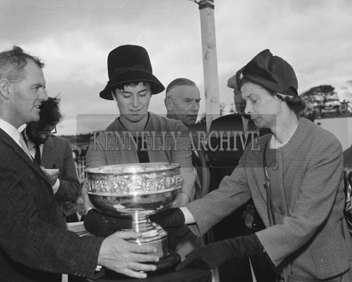 2nd September 1964; Rose of Tralee Margaret O'Keeffe presents the Carling Rose Bowl to Mrs King-Harmon, owner of 'Bonne', the winner the Carling Black Label Stakes at Ballybeggan Park, Tralee.