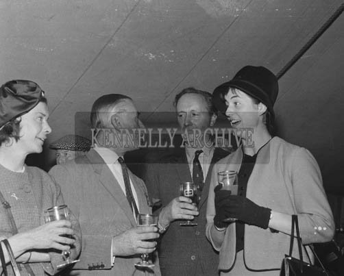 2nd September 1964; Rose of Tralee Margaret O'Keeffe shares a joke with Mrs King-Harmon, owner of 'Bonne', the winner the Carling Black Label Stakes, and Richard Beamish (2nd from left), at Ballybeggan Park, Tralee.