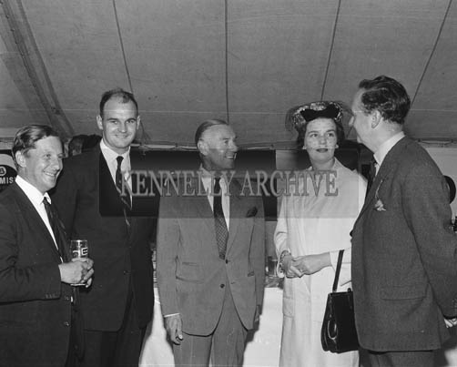 2nd September 1964; Niall Sheehy (second from left), with a group at Tralee Races in Ballybeggan.