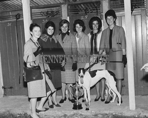 3rd September 1964; The Roses pose with a winning dog at the greyhound racing in Tralee during the Festival of Kerry.
