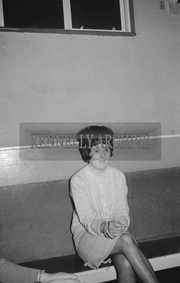 5th January 1964; A photo of a woman at a dance in Ballymacelligott. Music at the dance was provided by the Telstars Showband.