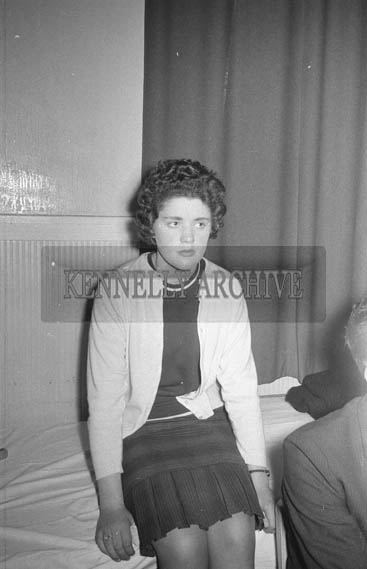 9th January 1964; A woman at the Kilmoyley Social in the Hotel Manhattan, Tralee. Music at the dance was provided by the Rhythm Aces.