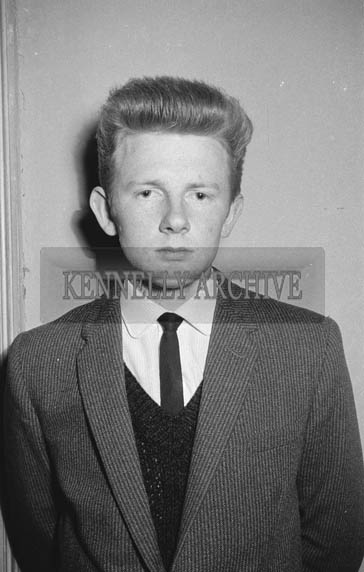 15th January 1964; A photo of a young man at a dance in the CYMS in Tralee. Music at the dance was provided by the Royal Showband.