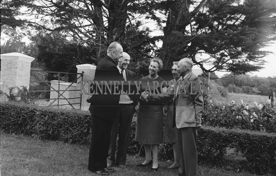 September 1964; His Excellency Most Reverend Archbishop McGuckan of San Francisco at the home of his cousin, James Tagney, Leebrook, Tralee. The Archbishop was on his way to Rome. He celebrated Holy Mass in the Presentation Convent in Castleisland, where his mother was from. L to R: Most Reverend Joseph T. McGuckan, James Tagney, Mrs Hayes, Mrs Tagney, and Commandant Sean Hayes.