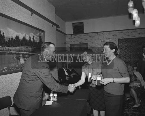 13th September 1964; Liam Wolfe, President of Ballybunion Development Association, presenting the prize for Kerry's best pair to Mrs McWicka and Mrs McKenzie- Vass at Watney's Bridge tournament in Ballybunion.