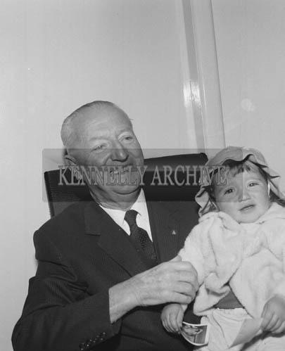September 1964; A photo of Dr Eamonn O'Sullivan with a girl.