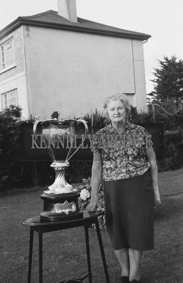 September 1964; A photo of Mrs Bill Landers with the Jack Dempsey Trophy.
