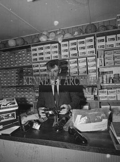 September 1964; A photo of Kerry Footballer John Dowling in his shoe shop.
