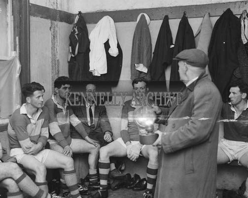September 1964; Senior Kerry Football Team Trainer Dr Eamonn O'Sullivan speaks to the players in the dressing room at a training session in Austin Stack Park in Tralee.