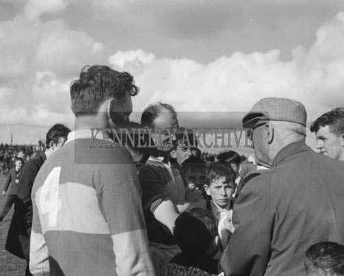 September 1964; Niall Sheehy and Dr Eamonn O'Sullivan at the Kerry Trial Match where selectors chose the team to play Galway in the All-Ireland Final. Mick Morris is on the right.