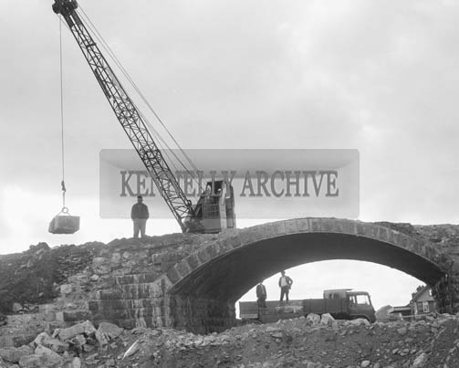 October 1964; A photo of the Castlemaine Railway Bridge. The bridge was built to convey road traffic over the Farranfore-Valentia Rail line, and was demolished as part of the Roads Improvemnet Scheme.