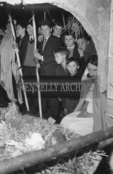 6th January 1964; A photo of the final scene of the Epiphany Pageant in Castlegregory, 'The Adoration of the Infant'. The cast were: Mary Keane, Kellyheight, (Our Lady); Conor Nolan, St Brendan's Co-Operative Society's Advisory Services, (St Joseph); Sean Keane, Kellyheight, (Balthasar the Wise Man); P Courtney, Maharees, (Melchior the Wise Man); Michael Rohan, Castlegregory, (Caspar the Wise Man); Bob Fitzgerald, Coolroe and John Paul Donovan, Castlegregory, (Shepherds).