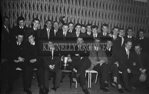 9th January 1964; A group of men pose for the camera at the Tarbert Milk Suppliers Dance in the Hotel Manhattan, Tralee. Michael O'Leary, Kingdom Mart Ltd, is in the front row, second from the right.