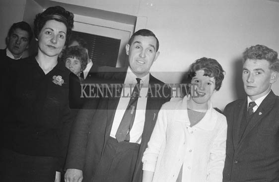 January 1964; Pat McElligott (centre) with a group of people at a social.