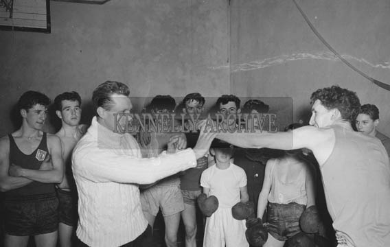 January 1964; A group of boys in Tralee Desmond Boxing training with ex Irish International and club trainer Denis Brassil (in the white polo neck).