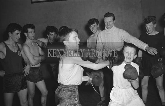 January 1964; Michael O'Brien (front left) and Ray Houlihan in Tralee Desmond Boxing training with ex Irish International and club trainer Denis Brassil (in the white polo neck).