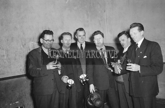 January 1964; Members of Tralee Desmond Boxing Club pose for the camera with their trophies. Arthur J. O'Leary is third from the right.