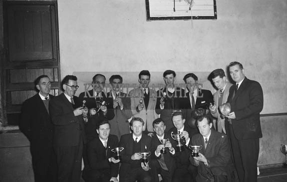 January 1964; Members of Tralee Desmond Boxing Club pose for the camera with their trophies. Arthur J. O'Leary is standing in the back row (third from right).