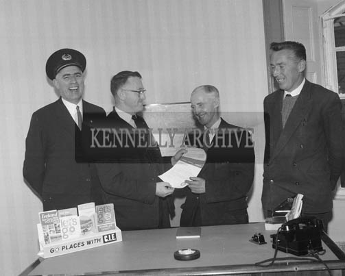 October 1964; Mr P. Hannigan, District Manager, CIE, presenting a Good Service Certificate & Cheque to Mr Michael Quinlan, Marion Park, Tralee, who retired after 41 years service to the Railway. Mr. Quinlan was the first man in Kerry to receive this award.