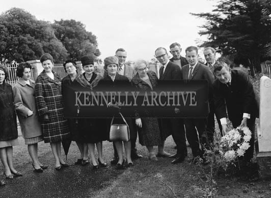 13th October 1964; Mr Florence O'Connor, Festival of Kerry President, lays a wreath at The Mulchinock Memorial Stone to mark the Centenary of the death of William Pembroke Mulchinock, who wrote the song 'The Rose of Tralee'. Members of the Festival of Kerry committee including Sheila Horan, Rita O'Leary, Jo Hussey, Nancy Caball, Jim Caball, George Rice and Margaret Dwyer, are also present.