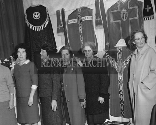 November 1964; A photo of women at an exhibition of Church vestments.